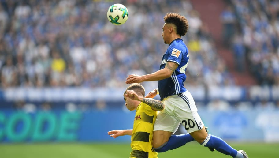 Dortmund's US midfielder Christian Pulisic (L) and Schalke's German defender Thilo Kehrer vie for the ball during the German first division Bundesliga football match of Schalke 04 vs Borussia Dortmund in Gelsenkirchen, western Germany, on April 15, 2018. / AFP PHOTO / Patrik STOLLARZ / RESTRICTIONS: DURING MATCH TIME: DFL RULES TO LIMIT THE ONLINE USAGE TO 15 PICTURES PER MATCH AND FORBID IMAGE SEQUENCES TO SIMULATE VIDEO. == RESTRICTED TO EDITORIAL USE == FOR FURTHER QUERIES PLEASE CONTACT DFL DIRECTLY AT + 49 69 650050         (Photo credit should read PATRIK STOLLARZ/AFP/Getty Images)