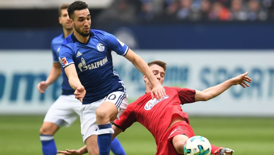 Freiburg's Swiss midfielder Vincent Sierro (R) and Schalke's Algerian midfielder Nabil Bentaleb (R) vie for the ball during the German first division Bundesliga football match between FC Schalke 04 v SC Freiburg in Gelsenkirchen, western Germany, on March 31, 2018. / AFP PHOTO / Patrik STOLLARZ / RESTRICTIONS: DURING MATCH TIME: DFL RULES TO LIMIT THE ONLINE USAGE TO 15 PICTURES PER MATCH AND FORBID IMAGE SEQUENCES TO SIMULATE VIDEO. == RESTRICTED TO EDITORIAL USE == FOR FURTHER QUERIES PLEASE CONTACT DFL DIRECTLY AT + 49 69 650050         (Photo credit should read PATRIK STOLLARZ/AFP/Getty Images)