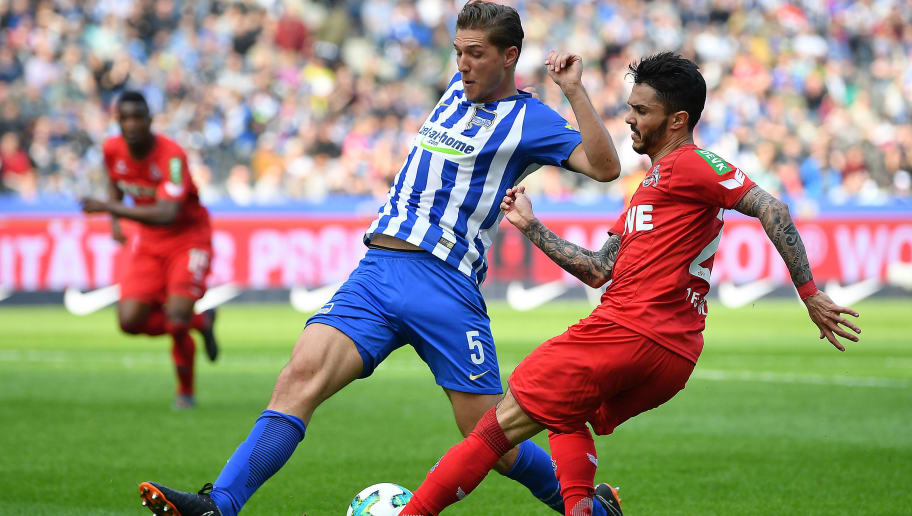 BERLIN, GERMANY - APRIL 14: Niklas Stark of Berlin (l) runs with Leonardo Bittencourt of Koeln during the Bundesliga match between Hertha BSC and 1. FC Koeln at Olympiastadion on April 14, 2018 in Berlin, Germany. (Photo by Stuart Franklin/Bongarts/Getty Images)