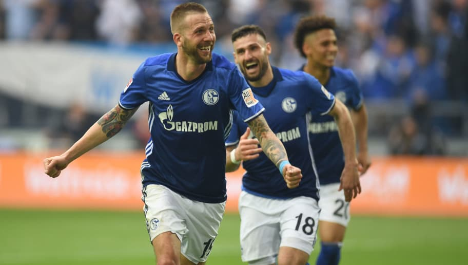 Schalke's Austrian forward Guido Burgstaller celebrates during the German first division Bundesliga football match FC Schalke 04 vs Borussia Dortmund, in Gelsenkirchen, western Germany, on April 15, 2018. / AFP PHOTO / Patrik STOLLARZ / RESTRICTIONS: DURING MATCH TIME: DFL RULES TO LIMIT THE ONLINE USAGE TO 15 PICTURES PER MATCH AND FORBID IMAGE SEQUENCES TO SIMULATE VIDEO. == RESTRICTED TO EDITORIAL USE == FOR FURTHER QUERIES PLEASE CONTACT DFL DIRECTLY AT + 49 69 650050         (Photo credit should read PATRIK STOLLARZ/AFP/Getty Images)