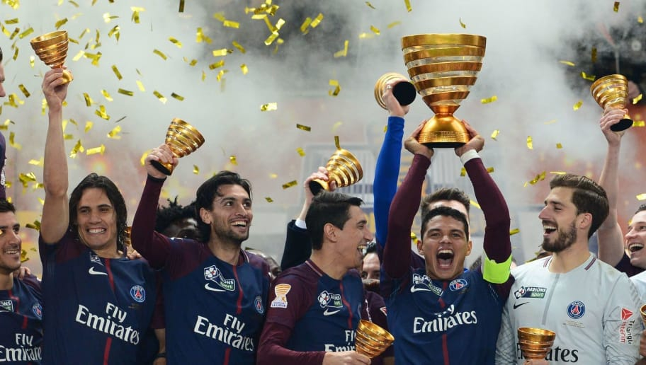 TOPSHOT - Paris Saint-Germain's Brazilian defender Thiago Silva (C) holds the trophy as he celebrates with teammates German goalkeeper Kevin Trapp (2R), French goalkeeper Alphonse Areola (R), French defender Presnel Kimpembe (R) Argentinian forward Angel Di Maria (3L), Argentinian midfielder Javier Pastore (2L) and Uruguayan forward Edinson Cavani (L) after victory in the French League Cup final football match between Monaco (ASM) and Paris Saint-Germain (PSG) at The Matmut Atlantique Stadium in Bordeaux, southwestern France on March 31, 2018.  / AFP PHOTO / NICOLAS TUCAT        (Photo credit should read NICOLAS TUCAT/AFP/Getty Images)