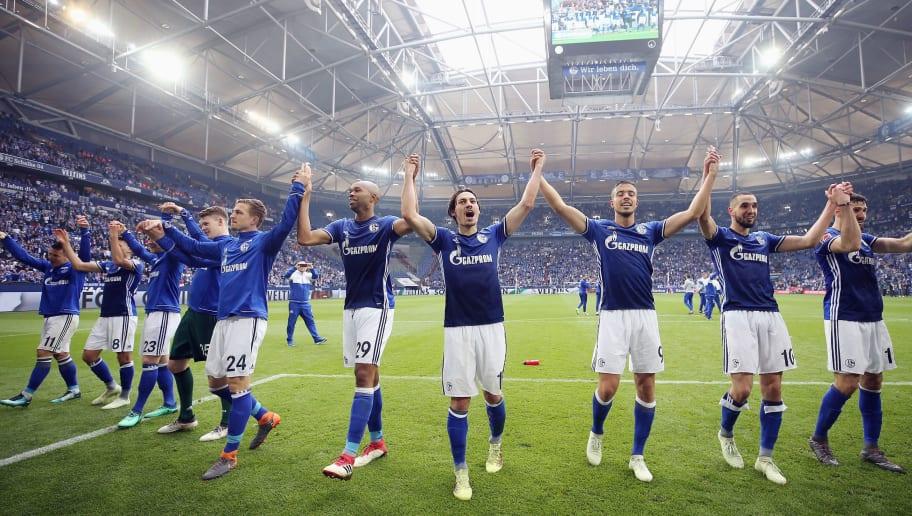 GELSENKIRCHEN, GERMANY - APRIL 15:  Players of Schalke celebrate after the Bundesliga match between FC Schalke 04 and Borussia Dortmund at Veltins-Arena on April 15, 2018 in Gelsenkirchen, Germany.  (Photo by Alex Grimm/Bongarts/Getty Images)