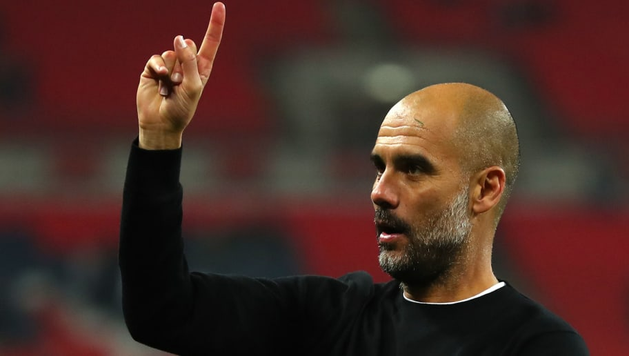LONDON, ENGLAND - APRIL 14: Josep Guardiola, Manager of Manchester City raises one finger to indicate one more game after the Premier League match between Tottenham Hotspur and Manchester City at Wembley Stadium on April 14, 2018 in London, England.  (Photo by Catherine Ivill/Getty Images)