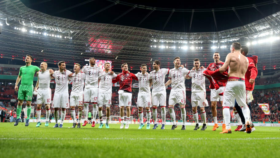 LEVERKUSEN, GERMANY - APRIL 17:  Team members of Muenchen celebrate victory after the DFB Cup semi final match between Bayer 04 Leverkusen and Bayern Munchen at BayArena on April 17, 2018 in Leverkusen, Germany.  (Photo by Alex Grimm/Bongarts/Getty Images)