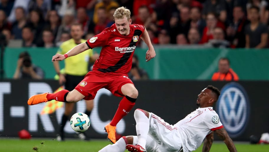 LEVERKUSEN, GERMANY - APRIL 17: Julian Brandt (L) of Lerverkusen and Jerome Boateng of Bayern battle for the ball during the DFB Cup semi final match between Bayer 04 Leverkusen and Bayern Munchen at BayArena on April 17, 2018 in Leverkusen, Germany.  (Photo by Alex Grimm/Bongarts/Getty Images)