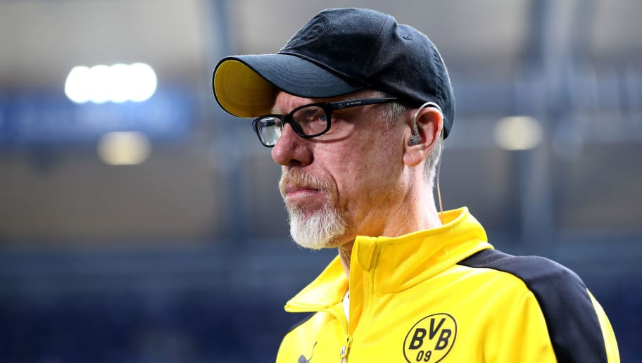 GELSENKIRCHEN, GERMANY - APRIL 15:  Peter Stoeger, head coach of Dortmund looks on before the Bundesliga match between FC Schalke 04 and Borussia Dortmund at Veltins-Arena on April 15, 2018 in Gelsenkirchen, Germany.  (Photo by Alex Grimm/Bongarts/Getty Images)