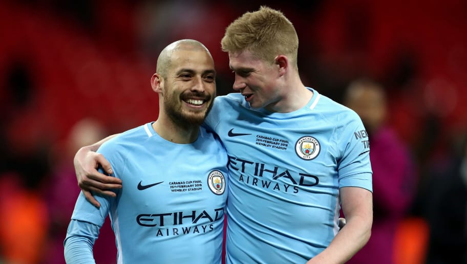 LONDON, ENGLAND - FEBRUARY 25:  David Silva and Kevin De Bruyne of Manchester City celebrate after the Carabao Cup Final between Arsenal and Manchester City at Wembley Stadium on February 25, 2018 in London, England.  (Photo by Catherine Ivill/Getty Images)