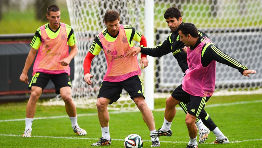 CURITIBA, BRAZIL - JUNE 15: (L-R) Cesar Azpilicueta, Xabi Alonso, Diego Costa and Xavi Hernandez of Spain in action during a Spain training session at Centro de Entrenamiento do Caju on June 15, 2014 in Curitiba, Brazil. (Photo by David Ramos/Getty Images)