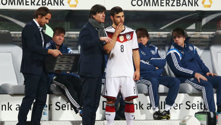 NUREMBERG, GERMANY - NOVEMBER 14: Head coach Joachim Loew of Germany talks to Kevin Volland during the EURO 2016 Qualifier between Germany and Gibraltar and Grundig-Stadion on November 14, 2014 in Nuremberg, Germany.  (Photo by Alex Grimm/Bongarts/Getty Images)