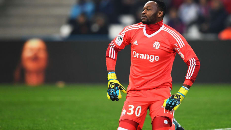 Olympique de Marseille's French goalkeeper Steve Mandanda reacts after Troyes' French midfielder Bryan Pele scored a goal during the French L1 football match between Olympique de Marseille (OM) and Troyes on December 20, 2017 at the Velodrome stadium in Marseille, southern France. / AFP PHOTO / ANNE-CHRISTINE POUJOULAT        (Photo credit should read ANNE-CHRISTINE POUJOULAT/AFP/Getty Images)