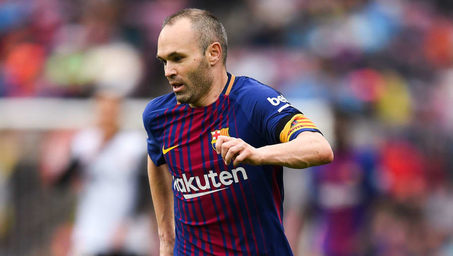 BARCELONA, SPAIN - APRIL 14:  Andres Iniesta of FC Barcelona runs with the ball during the La Liga match between Barcelona and Valencia at Camp Nou on April 14, 2018 in Barcelona, Spain.  (Photo by David Ramos/Getty Images)