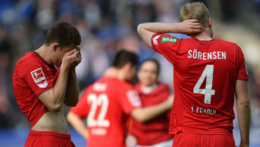 BERLIN, GERMANY - APRIL 14:  Dominique Heintz and Frederik Sorensen of Cologne look dejected after the Bundesliga match between Hertha BSC and 1. FC Koeln at Olympiastadion on April 14, 2018 in Berlin, Germany.  (Photo by Stuart Franklin/Bongarts/Getty Images)