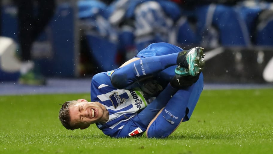 BERLIN, GERMANY - DECEMBER 13: Mitchell Weiser of Hertha BSC takes an injury during the Bundesliga match between Hertha BSC and Hannover 96 at Olympiastadion on December 13, 2017 in Berlin, Germany.  (Photo by Boris Streubel/Bongarts/Getty Images )