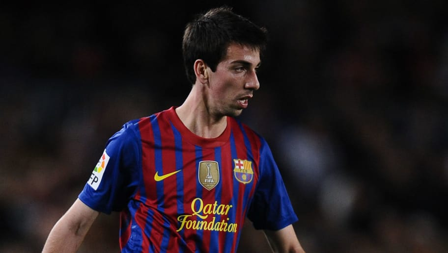 BARCELONA, SPAIN - APRIL 10:  Isaac Cuenca of FC Barcelona runs with the ball during the La Liga match between FC Barcelona and Getafe CF at Camp Nou on April 10, 2012 in Barcelona, Spain. FC Barcelona won 4-0.  (Photo by David Ramos/Getty Images)