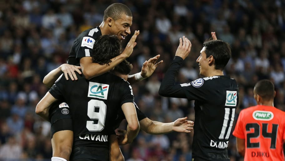 Paris Saint-Germain's Uruguayan forward Edinson Cavani celebrates with teammate French forward Kylian Mbappé and Paris Saint-Germain's Argentinian forward Angel Di Maria (R) after scoring during the French Cup semi-final football match between Caen (SMC) and Paris (PSG) on April 18, 2018, at the Michel d'Ornano stadium, in Caen, northwestern France. / AFP PHOTO / CHARLY TRIBALLEAU        (Photo credit should read CHARLY TRIBALLEAU/AFP/Getty Images)