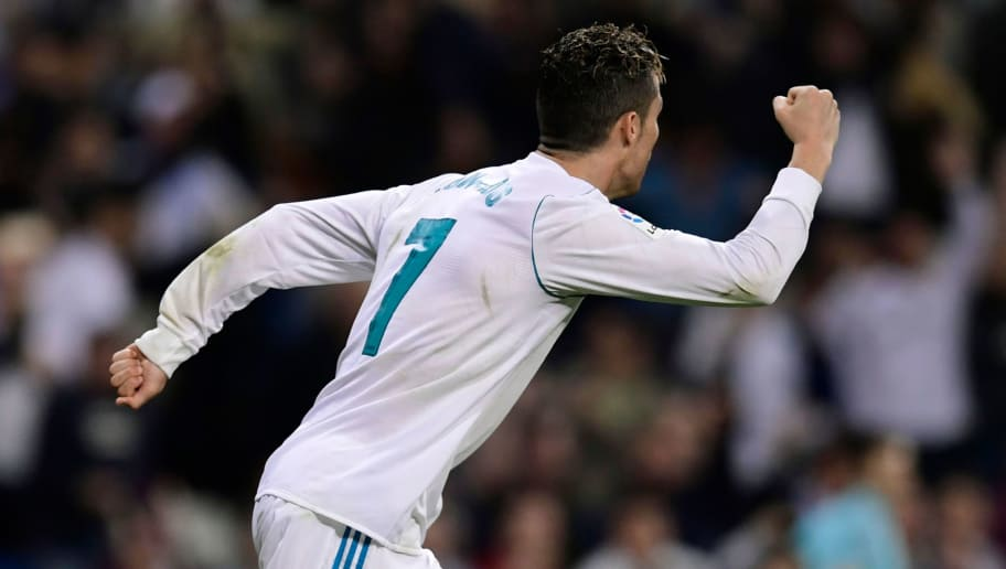 Real Madrid's Portuguese forward Cristiano Ronaldo celebrates after scoring during the Spanish league football match Real Madrid CF against Athletic Club Bilbao at the Santiago Bernabeu stadium in adrid on April 18, 2018. / AFP PHOTO / JAVIER SORIANO        (Photo credit should read JAVIER SORIANO/AFP/Getty Images)