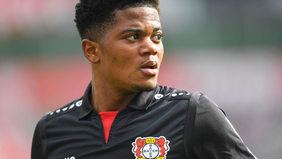 Leverkusen's Jamaican midfielder Leon Bailey reacts during the German first division Bundesliga football match Bayer 04 Leverkusen vs Eintracht Frankfurt, in Leverkusen, western Germany, on April 14, 2018. / AFP PHOTO / Patrik STOLLARZ / RESTRICTIONS: DURING MATCH TIME: DFL RULES TO LIMIT THE ONLINE USAGE TO 15 PICTURES PER MATCH AND FORBID IMAGE SEQUENCES TO SIMULATE VIDEO. == RESTRICTED TO EDITORIAL USE == FOR FURTHER QUERIES PLEASE CONTACT DFL DIRECTLY AT + 49 69 650050         (Photo credit should read PATRIK STOLLARZ/AFP/Getty Images)