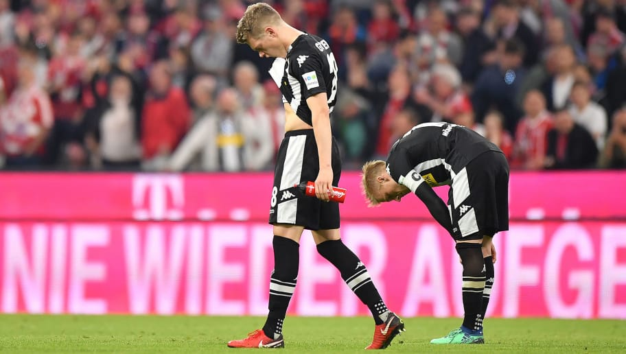 MUNICH, GERMANY - APRIL 14: Matthias Ginter of Moenchengladbach (l) looks decked after the Bundesliga match between FC Bayern Muenchen and Borussia Moenchengladbach at Allianz Arena on April 14, 2018 in Munich, Germany. (Photo by Sebastian Widmann/Bongarts/Getty Images,)
