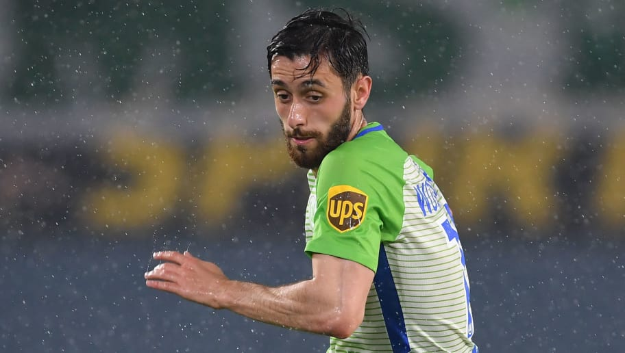 WOLFSBURG, GERMANY - APRIL 13:  Yunus Malli of Wolfsburg in action  during the Bundesliga match between VfL Wolfsburg and FC Augsburg at Volkswagen Arena on April 13, 2018 in Wolfsburg, Germany.  (Photo by Stuart Franklin/Bongarts/Getty Images)