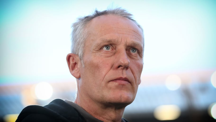 MAINZ, GERMANY - APRIL 16:  (EDITORS NOTE; This image was processed using digital filters.) Christian Streich, head coach of Freiburg looks on prior to the Bundesliga match between 1. FSV Mainz 05 and Sport-Club Freiburg at Opel Arena on April 16, 2018 in Mainz, Germany.  (Photo by Alex Grimm/Bongarts/Getty Images)