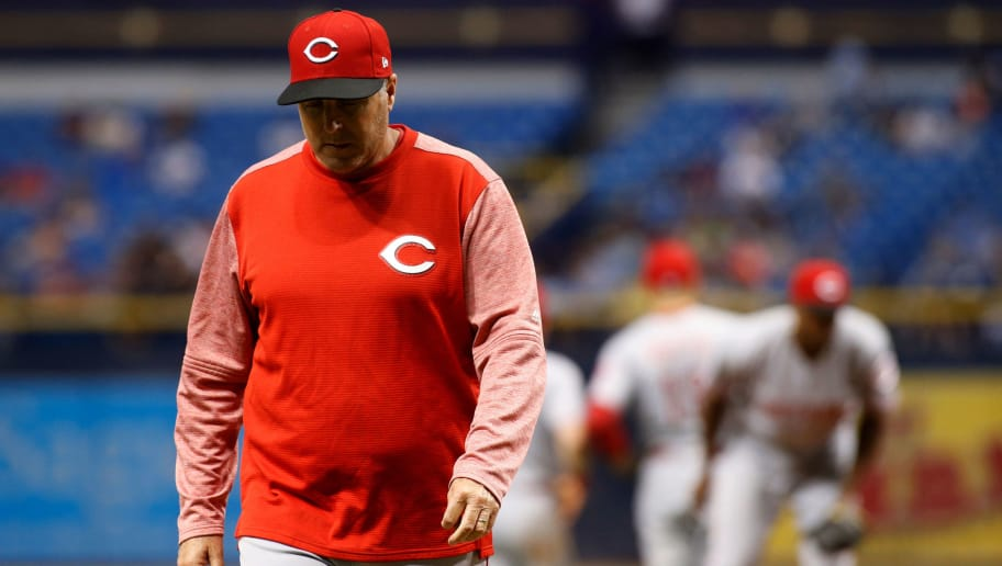 ST. PETERSBURG, FL - JUNE 20:  Manager Bryan Price #38 of the Cincinnati Reds makes his way back to the dugout after taking pitcher Amir Garrett #50 off the mound during the fourth inning of a game against the Tampa Bay Rays on June 20, 2017 at Tropicana Field in St. Petersburg, Florida. (Photo by Brian Blanco/Getty Images)