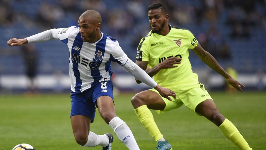 Porto's Algerian forward Yacine Brahimi (L) challenges Aves' Brazilian midfielder Nildo Petrolina during the Portuguese league football match between FC Porto and CD Aves at the Dragao stadium in Porto on April 8, 2018. / AFP PHOTO / MIGUEL RIOPA        (Photo credit should read MIGUEL RIOPA/AFP/Getty Images)
