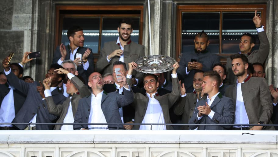 MUNICH, GERMANY - MAY 20:  Philipp Lahm of Bayern Muenchen celebrates winning the 67th German Championship title on the town hall balcony at Marienplatz on May 20, 2017 in Munich, Germany.  (Photo by Alexandra Beier/Bongarts/Getty Images)