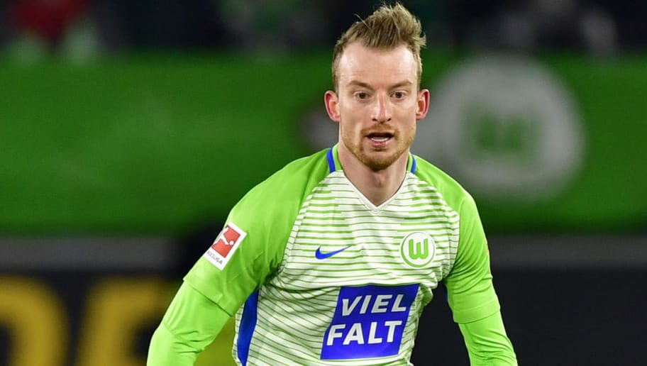 Wolfsburg's German midfielder Maximilian Arnold runs with the ball during the German First division Bundesliga football match VfL Wolfsburg vs Schalke 04, in Wolfsburg, on March 17, 2018. / AFP PHOTO / John MACDOUGALL / RESTRICTIONS: DURING MATCH TIME: DFL RULES TO LIMIT THE ONLINE USAGE TO 15 PICTURES PER MATCH AND FORBID IMAGE SEQUENCES TO SIMULATE VIDEO. == RESTRICTED TO EDITORIAL USE == FOR FURTHER QUERIES PLEASE CONTACT DFL DIRECTLY AT + 49 69 650050  / RESTRICTIONS: DURING MATCH TIME: DFL RULES TO LIMIT THE ONLINE USAGE TO 15 PICTURES PER MATCH AND FORBID IMAGE SEQUENCES TO SIMULATE VIDEO. == RESTRICTED TO EDITORIAL USE == FOR FURTHER QUERIES PLEASE CONTACT DFL DIRECTLY AT + 49 69 650050        (Photo credit should read JOHN MACDOUGALL/AFP/Getty Images)