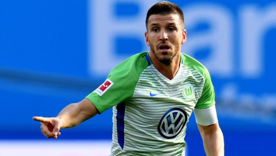 Wolfsburg´s Spanish midfielder Ignacio Camacho plays the ball during the German first division Bundesliga football match Bayer Leverkusen vs VfL Wolfsburg in Leverkusen, western Germany, on October 15, 2017. / AFP PHOTO / PATRIK STOLLARZ / RESTRICTIONS: DURING MATCH TIME: DFL RULES TO LIMIT THE ONLINE USAGE TO 15 PICTURES PER MATCH AND FORBID IMAGE SEQUENCES TO SIMULATE VIDEO. == RESTRICTED TO EDITORIAL USE == FOR FURTHER QUERIES PLEASE CONTACT DFL DIRECTLY AT + 49 69 650050         (Photo credit should read PATRIK STOLLARZ/AFP/Getty Images)