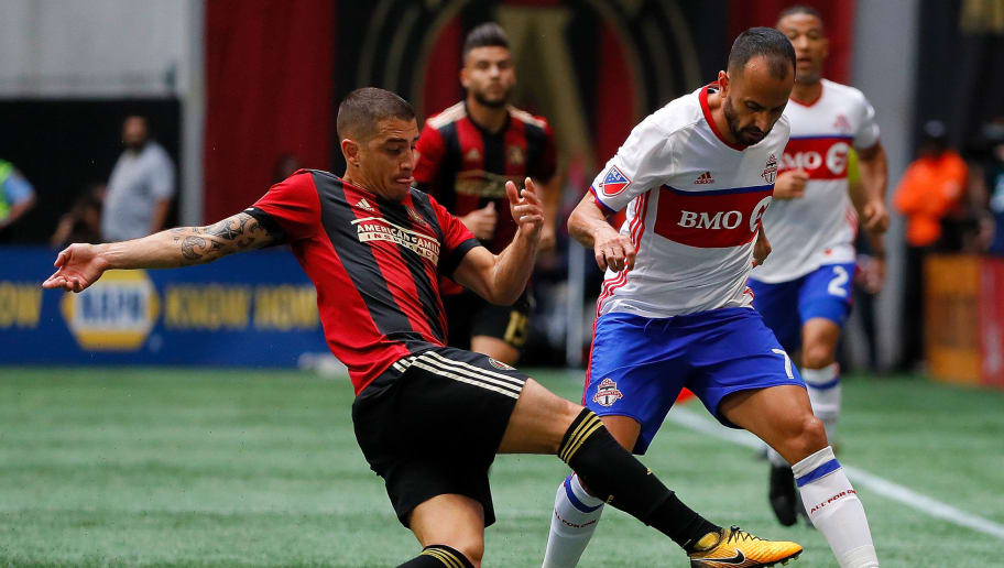 ATLANTA, GA - OCTOBER 22:  Carlos Carmona #14 of Atlanta United challenges Victor Vazquez #7 of Toronto FC at Mercedes-Benz Stadium on October 22, 2017 in Atlanta, Georgia.  (Photo by Kevin C. Cox/Getty Images)