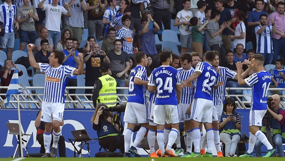 Real Sociedad players celebrate their opening goal during the Spanish league football between Real Sociedad and Club Atletico de Madrid at the Anoeta stadium in San Sebastian on April 19, 2018. (Photo by ANDER GILLENEA / AFP)        (Photo credit should read ANDER GILLENEA/AFP/Getty Images)