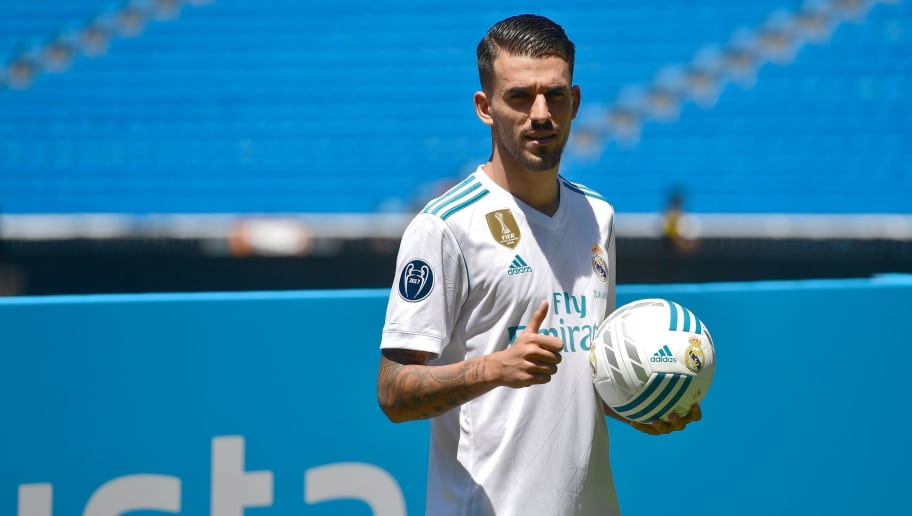 Spanish midfielder Dani Ceballos gives a thumb up as he poses on the pitch during his presentation as new football player of the Real Madrid CF at the Santiago Bernabeu stadium in Madrid on July 20, 2017. / AFP PHOTO / PIERRE-PHILIPPE MARCOU        (Photo credit should read PIERRE-PHILIPPE MARCOU/AFP/Getty Images)