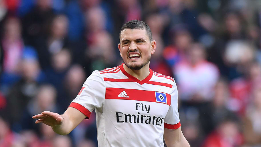 MUNICH, GERMANY - MARCH 10: Kyriakos Papadopoulos of Hamburg looks dejected during the Bundesliga match between FC Bayern Muenchen and Hamburger SV at Allianz Arena on March 10, 2018 in Munich, Germany. (Photo by Sebastian Widmann/Bongarts/Getty Images)