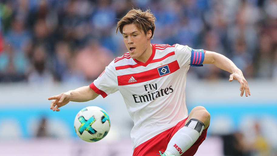 SINSHEIM, GERMANY - APRIL 14: Gotoku Sakai of Hamburg plays the ball during the Bundesliga match between TSG 1899 Hoffenheim and Hamburger SV at Wirsol Rhein-Neckar-Arena on April 14, 2018 in Sinsheim, Germany. (Photo by Simon Hofmann/Bongarts/Getty Images)
