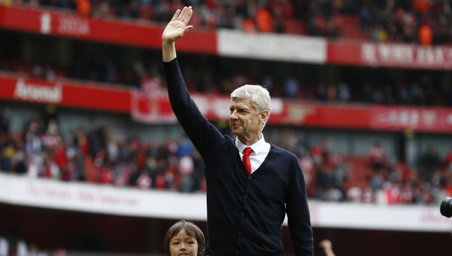 Arsenal's French manager Arsene Wenger waves to supporters after the English Premier League football match between Arsenal and West Bromwich Albion at the Emirates Stadium in London on May 24, 2015. Arsenal won the game 4-1. AFP PHOTO / JUSTIN TALLIS  RESTRICTED TO EDITORIAL USE. NO USE WITH UNAUTHORIZED AUDIO, VIDEO, DATA, FIXTURE LISTS, CLUB/LEAGUE LOGOS OR LIVE SERVICES. ONLINE IN-MATCH USE LIMITED TO 45 IMAGES, NO VIDEO EMULATION. NO USE IN BETTING, GAMES OR SINGLE CLUB/LEAGUE/PLAYER PUBLICATIONS.        (Photo credit should read JUSTIN TALLIS/AFP/Getty Images)