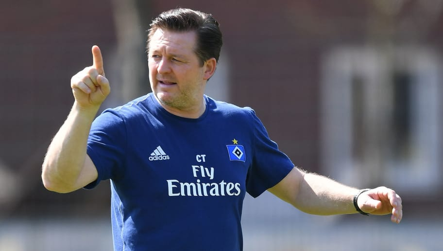 HAMBURG, GERMANY - APRIL 18:  Christian Titz, head coach of Hamburg gestures during a training session of Hamburger SV at Volksparkstadion on April 18, 2018 in Hamburg, Germany.  (Photo by Stuart Franklin/Bongarts/Getty Images)