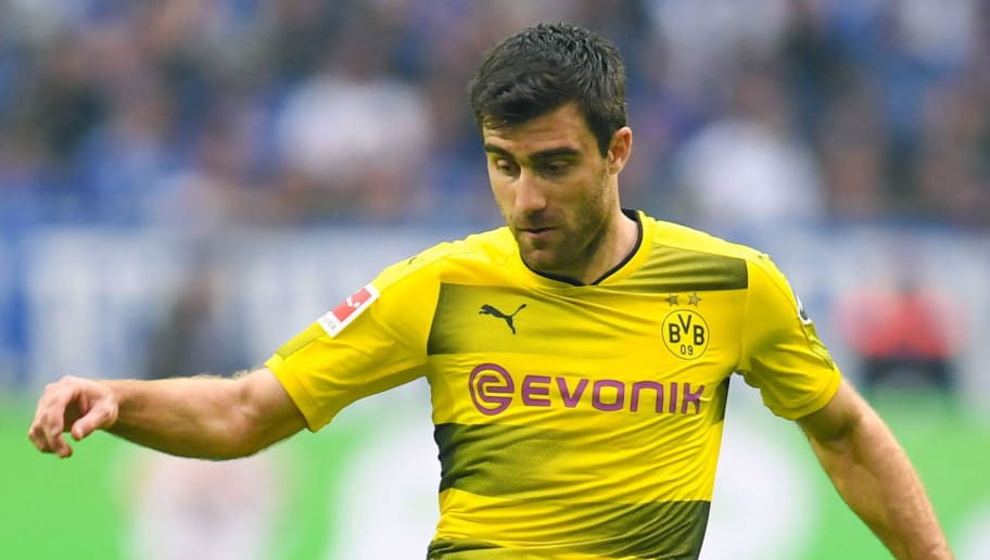 Dortmund's Greek defender Sokratis controls the ball during the German first division Bundesliga football match FC Schalke 04 vs Borussia Dortmund, in Gelsenkirchen, western Germany, on April 15, 2018. / AFP PHOTO / Patrik STOLLARZ / RESTRICTIONS: DURING MATCH TIME: DFL RULES TO LIMIT THE ONLINE USAGE TO 15 PICTURES PER MATCH AND FORBID IMAGE SEQUENCES TO SIMULATE VIDEO. == RESTRICTED TO EDITORIAL USE == FOR FURTHER QUERIES PLEASE CONTACT DFL DIRECTLY AT + 49 69 650050         (Photo credit should read PATRIK STOLLARZ/AFP/Getty Images)