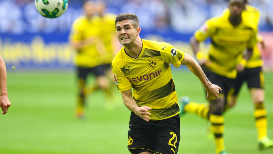Dortmund's US midfielder Christian Pulisic vies for the ball during the German first division Bundesliga football match FC Schalke 04 vs Borussia Dortmund, in Gelsenkirchen, western Germany, on April 15, 2018. / AFP PHOTO / Patrik STOLLARZ / RESTRICTIONS: DURING MATCH TIME: DFL RULES TO LIMIT THE ONLINE USAGE TO 15 PICTURES PER MATCH AND FORBID IMAGE SEQUENCES TO SIMULATE VIDEO. == RESTRICTED TO EDITORIAL USE == FOR FURTHER QUERIES PLEASE CONTACT DFL DIRECTLY AT + 49 69 650050         (Photo credit should read PATRIK STOLLARZ/AFP/Getty Images)