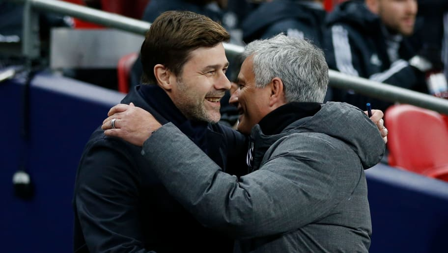 Manchester United's Portuguese manager Jose Mourinho (R) greets Tottenham Hotspur's Argentinian head coach Mauricio Pochettino (L) for the English Premier League football match between Tottenham Hotspur and Manchester United at Wembley Stadium in London, on January 31, 2018. / AFP PHOTO / IKIMAGES / Ian KINGTON / RESTRICTED TO EDITORIAL USE. No use with unauthorized audio, video, data, fixture lists, club/league logos or 'live' services. Online in-match use limited to 45 images, no video emulation. No use in betting, games or single club/league/player publications.  /         (Photo credit should read IAN KINGTON/AFP/Getty Images)