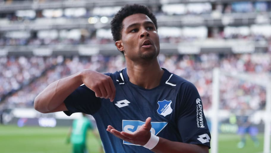FRANKFURT AM MAIN, GERMANY - APRIL 08:  Serge Gnabry of Hoffenheim celebrates his team's first goal during the Bundesliga match between Eintracht Frankfurt and TSG 1899 Hoffenheim at Commerzbank-Arena on April 8, 2018 in Frankfurt am Main, Germany.  (Photo by Alex Grimm/Bongarts/Getty Images)
