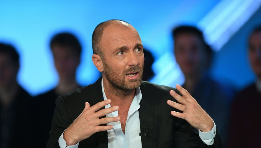 Former French international football player turned sports consultant, Christophe Dugarry speaks prior to the start of the TV show 'Canal Football Club' on March 27, 2016 in Paris.  / AFP / FRANCK FIFE        (Photo credit should read FRANCK FIFE/AFP/Getty Images)