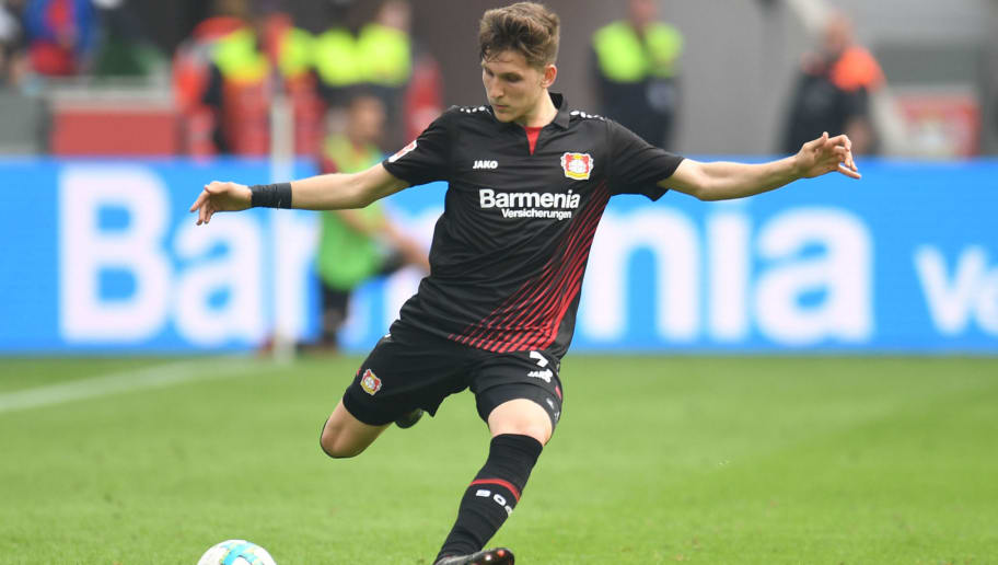 Leverkusen's Greek defender Panagiotis Retsos kicks the ball during the German first division Bundesliga football match Bayer 04 Leverkusen vs Eintracht Frankfurt, in Leverkusen, western Germany, on April 14, 2018. / AFP PHOTO / Patrik STOLLARZ / RESTRICTIONS: DURING MATCH TIME: DFL RULES TO LIMIT THE ONLINE USAGE TO 15 PICTURES PER MATCH AND FORBID IMAGE SEQUENCES TO SIMULATE VIDEO. == RESTRICTED TO EDITORIAL USE == FOR FURTHER QUERIES PLEASE CONTACT DFL DIRECTLY AT + 49 69 650050         (Photo credit should read PATRIK STOLLARZ/AFP/Getty Images)