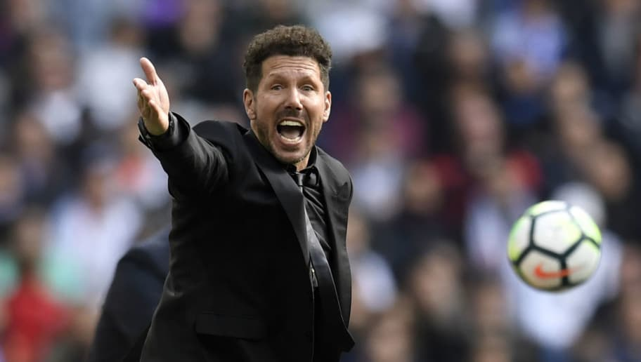 Atletico Madrid's Argentinian coach Diego Simeone reacts during the Spanish league football match between Real Madrid CF and Club Atletico de Madrid at the Santiago Bernabeu stadium in Madrid on April 8, 2018. / AFP PHOTO / GABRIEL BOUYS        (Photo credit should read GABRIEL BOUYS/AFP/Getty Images)
