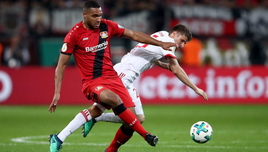 LEVERKUSEN, GERMANY - APRIL 17: Jonathan Tah (L) of Lerverkusen and Thomas Mueller of Bayern battle for the ball during the DFB Cup semi final match between Bayer 04 Leverkusen and Bayern Munchen at BayArena on April 17, 2018 in Leverkusen, Germany.  (Photo by Alex Grimm/Bongarts/Getty Images)