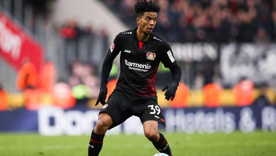 COLOGNE, GERMANY - MARCH 18: Benjamin Henrichs #39 of Bayer Leverkusen controls the ball during the Bundesliga match between 1. FC Koeln and Bayer 04 Leverkusen at RheinEnergieStadion on March 18, 2018 in Cologne, Germany. (Photo by Maja Hitij/Bongarts/Getty Images)
