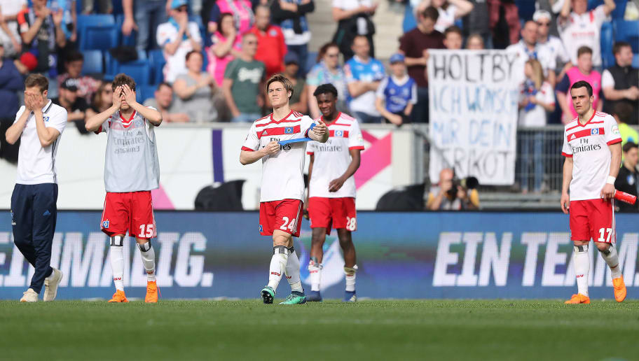 SINSHEIM, GERMANY - APRIL 14: Gotoku Sakai of Hamburg (c) and players of Hamburg look dejected after the Bundesliga match between TSG 1899 Hoffenheim and Hamburger SV at Wirsol Rhein-Neckar-Arena on April 14, 2018 in Sinsheim, Germany. (Photo by Simon Hofmann/Bongarts/Getty Images)