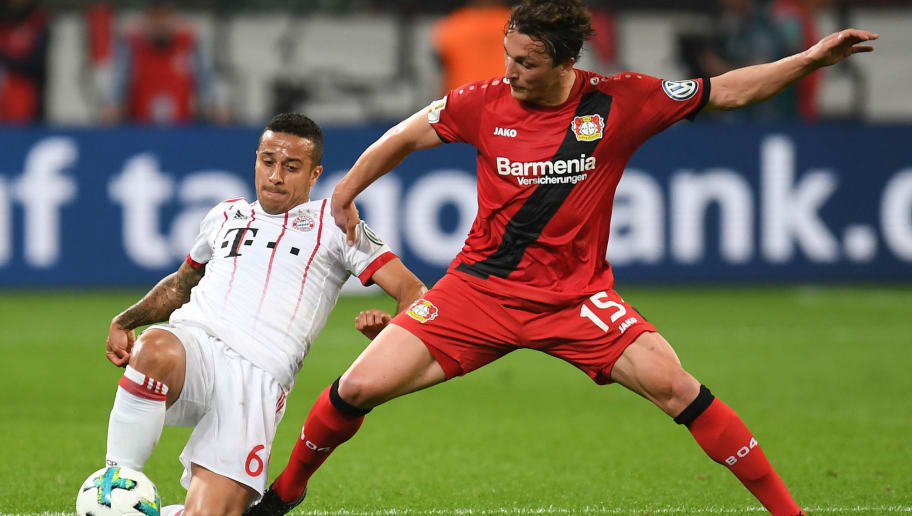 Bayern Munich's Spanish midfielder Thiago Alcantara (L) and Leverkusen's Austrian midflielder Julian Baumgartlinger vie for the ball during the German football Cup DFB Pokal semifinal match Bayer 04 Leverkusen vs Bayern Munich in Leverkusen, western Germany, on April 17, 2018. / AFP PHOTO / Patrik STOLLARZ / RESTRICTIONS: ACCORDING TO DFB RULES IMAGE SEQUENCES TO SIMULATE VIDEO IS NOT ALLOWED DURING MATCH TIME. MOBILE (MMS) USE IS NOT ALLOWED DURING AND FOR FURTHER TWO HOURS AFTER THE MATCH. == RESTRICTED TO EDITORIAL USE == FOR MORE INFORMATION CONTACT DFB DIRECTLY AT +49 69 67880   /         (Photo credit should read PATRIK STOLLARZ/AFP/Getty Images)