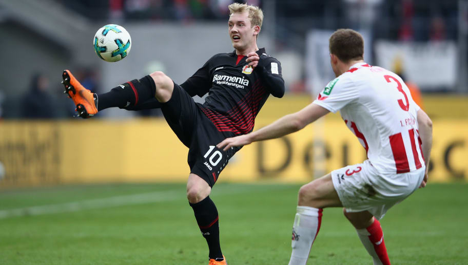 COLOGNE, GERMANY - MARCH 18: Julian Brandt (L) of Leverkusen is challenged by Dominique Heintz of Koeln during the Bundesliga match between 1. FC Koeln and Bayer 04 Leverkusen at RheinEnergieStadion on March 18, 2018 in Cologne, Germany.  (Photo by Alex Grimm/Bongarts/Getty Images)