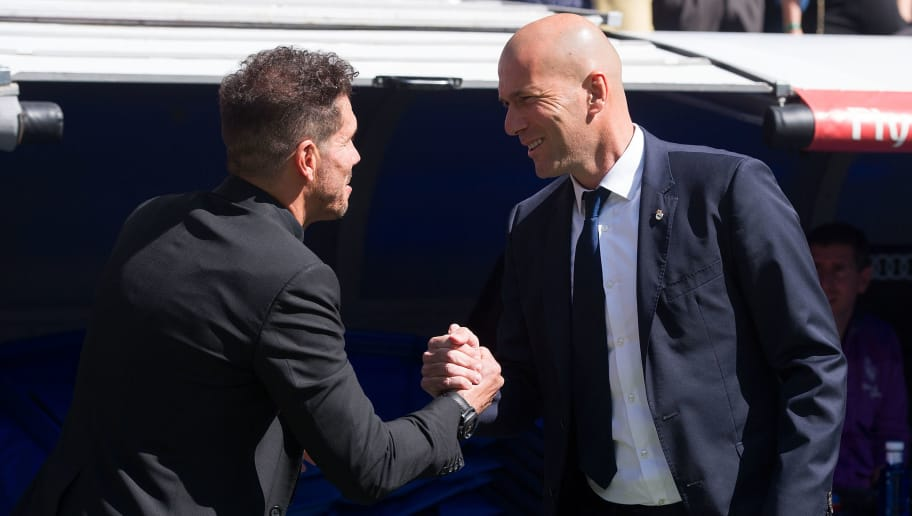 MADRID, SPAIN - APRIL 08:  Real Madrid manager Zinedine Zidane greets Head coach Diego Simeone of Club Atletico de Madri before the La Liga match between Real Madrid CF and Club Atletico de Madrid at Bernabeu   on April 8, 2017 in Madrid, Spain.  (Photo by Denis Doyle/Getty Images)