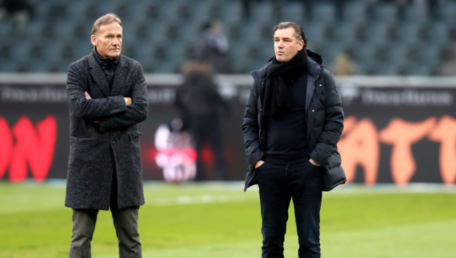 MOENCHENGLADBACH, GERMANY - FEBRUARY 18:      (L-R) Hans-Joachim Watzke, chairman of Dortmund and Michael Zorc, manager of Dortmund discuss about the quality ruined pitch prior to the Bundesliga match between Borussia Moenchengladbach and Borussia Dortmund at Borussia-Park on February 18, 2018 in Moenchengladbach, Germany. (Photo by Christof Koepsel/Bongarts/Getty Images)